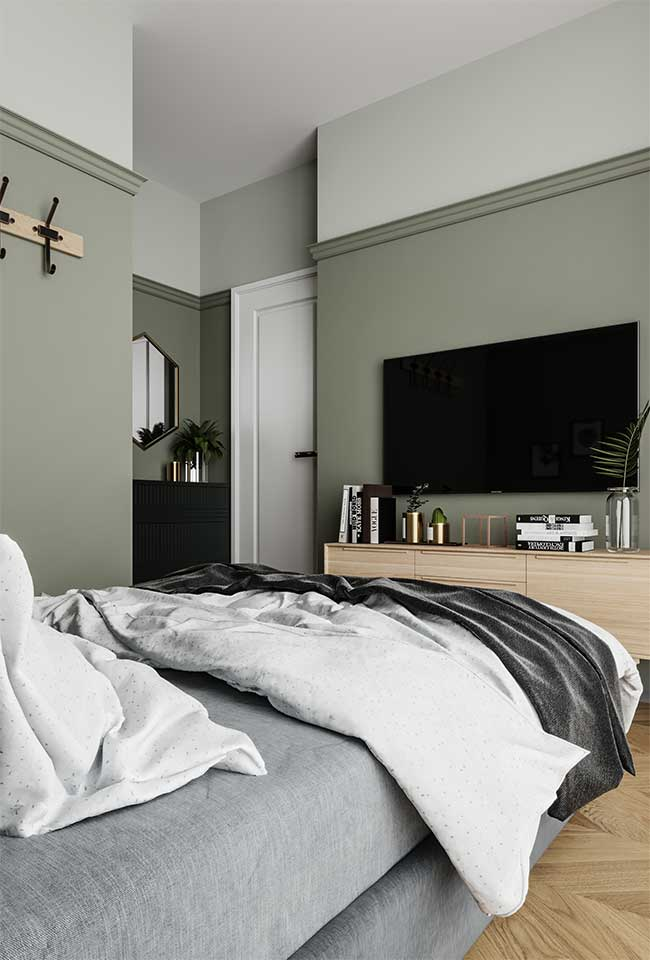 Les murs verts mousse apportent sobriété et un climat doux à la pièce